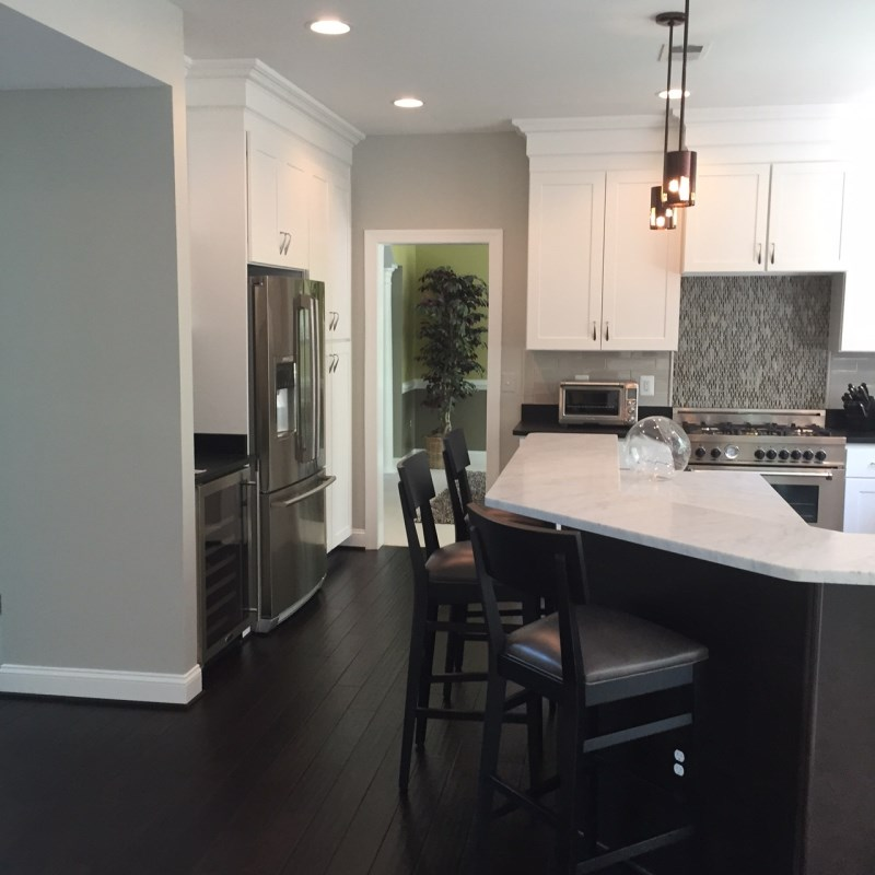 with the dark brown floors gives this kitchen both form and fashion when designing your own kitchen use dark and light cabinets or accessories to make the